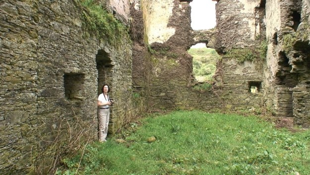 jean stands inside coppingers court ruins, ireland