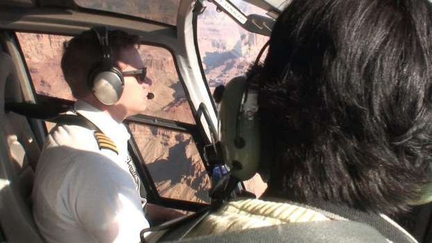 pilot fly helicopter above grand canyon