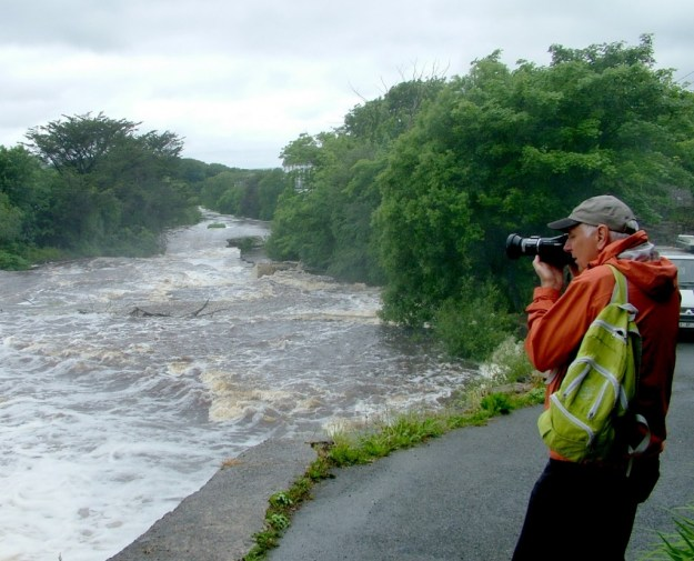 Bob films the Inagh river in Ennistymon, County Clare, Ireland