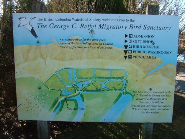 Entrance sign and map at Reifel Migratory Bird Sanctuary in Delta, BC, Canada.