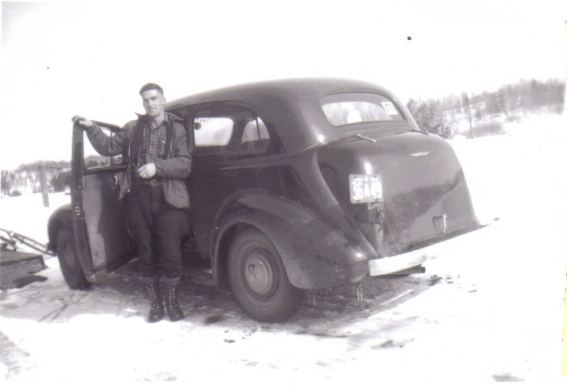 Marvin with his Chevy in the winter