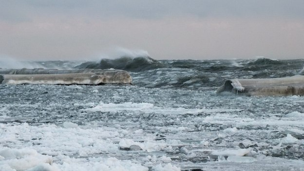 Icy waves breaking on Lake Ontario at Sunnyside in Toronto, Ontario, Canada