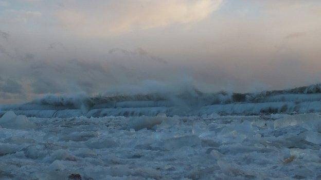 Icy waves breaking at Sunnyside on Lake Ontario in Toronto, Ontario, Canada