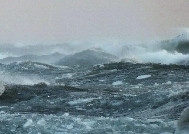 Icy waves on Lake Ontario off Sunnyside in Toronto, Ontario, Canada