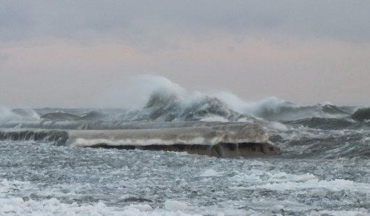 big waves with ice break over breakwater at sunnyside - toronto - jan 24 2014