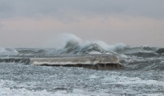 big waves with ice break over breakwater at sunnyside - toronto - jan 24 2014