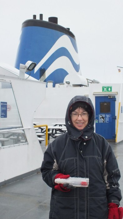 jean holds message in a bottle on BC ferry
