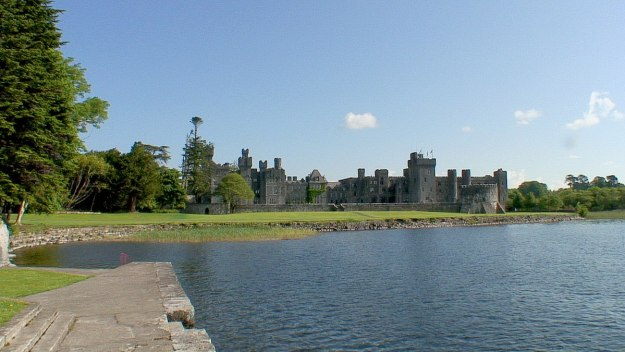 An image of Ashford Castle from the dock on Lake Corrib in County Mayo, Ireland. Photography by Frame To Frame - Bob and Jean.