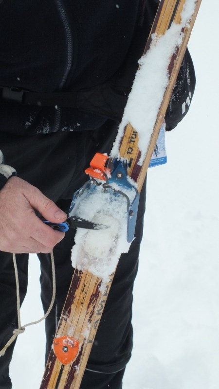cleaning ice of skis on pipestone trail - banff national park 2