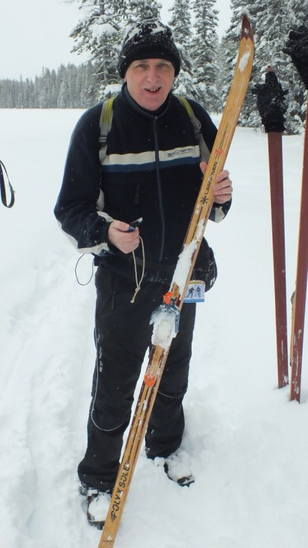 cleaning ice of skis on pipestone trail - banff national park