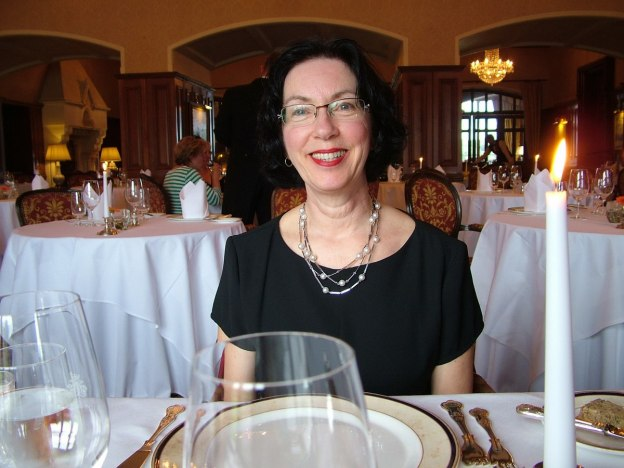 An image of Jean at dinner inside Ashford Castle in County Mayo in Ireland. Photography by Frame To Frame - Bob and Jean.