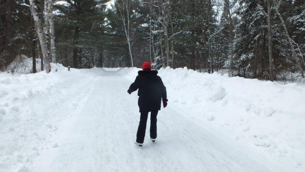 Jean skating on the ice skating trail at Arrowhead Provincial Park near Huntsville, Ontario, Canada