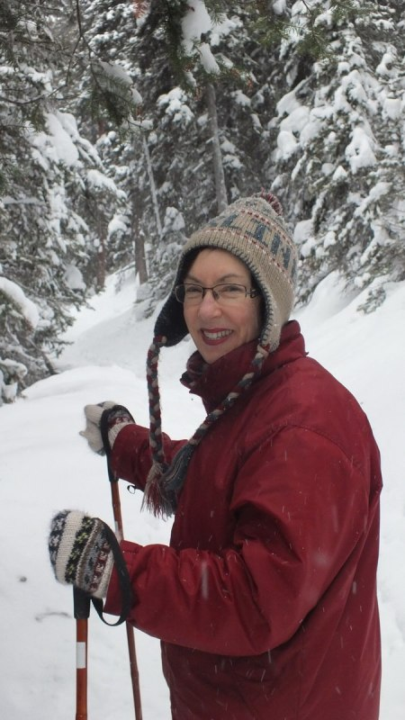 Jean snowshoeing on the Lake Agnes Trail at Banff National Park, in Alberta, Canada