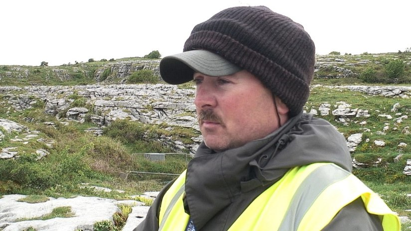An image of historical interpreter, Joe Clancy, at the Poulnabrone Dolmen in County Clare, Ireland. Photography by Frame To Frame - Bob and Jean.