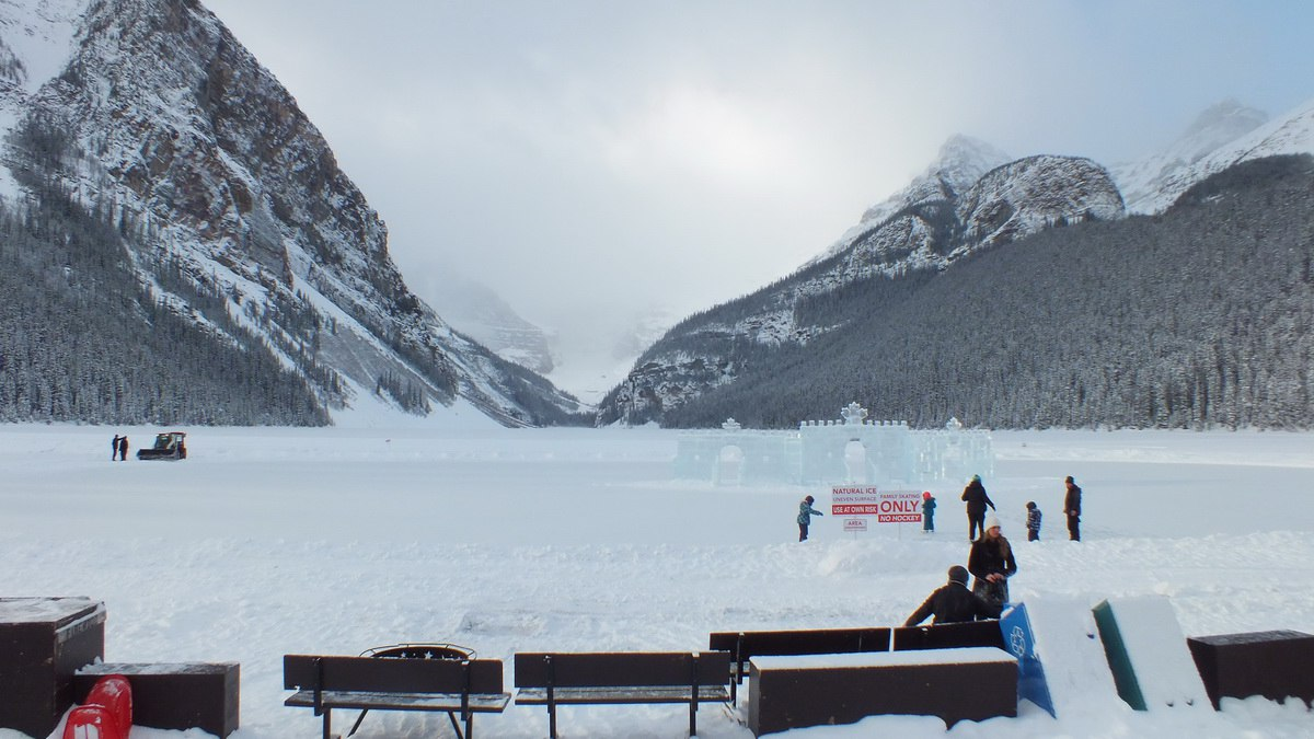 People skating on the ice rink on Lake Louise in Banff National Park, Alberta, Canada