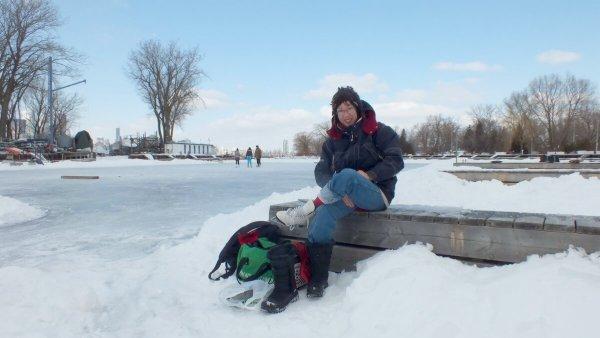 putting on skates at lagoon skating rink - ward's island - toronto