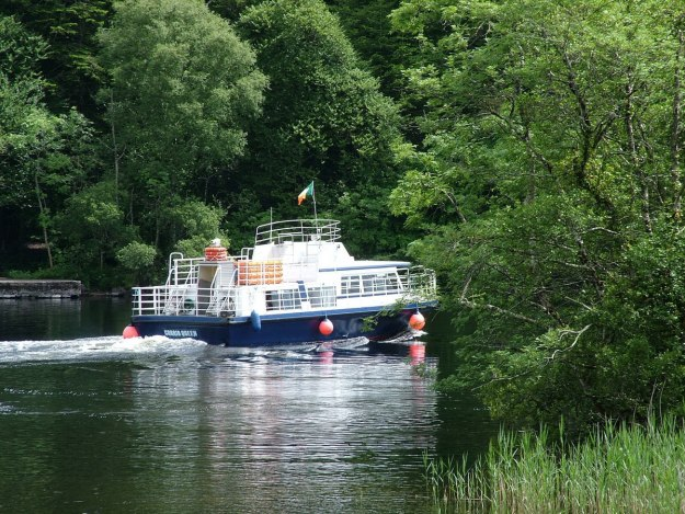 An image of a tour boat on the Cong Canal near Ashford Castle in County Mayo, Ireland. Photography by Frame To Frame - Bob and Jean.