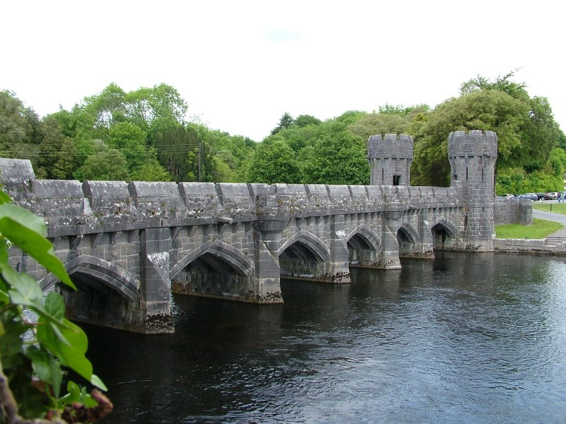 An image of the stone bridge with castle turrets at Ashford Castle on the Cong Canal in County Mayo, Ireland. Photography by Frame To Frame - Bob and Jean.
