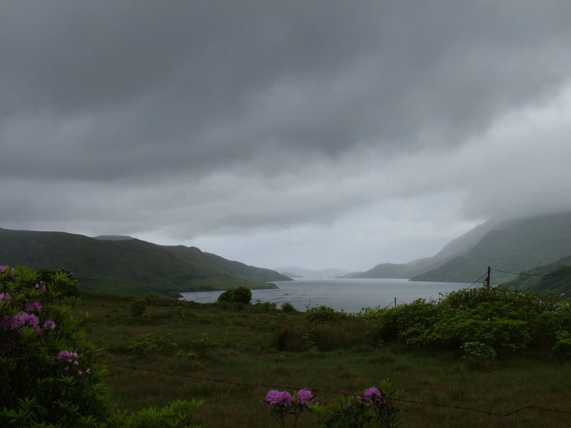 An image of cloudy skies over Pollacapall Lough at Kylemore Abbey in County Galway, Ireland. Photography by Frame To Frame - Bob and Jean.