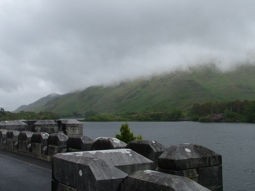 An image of cloudy mountains from Kylemore Abbey on Pollacapall Lough in County Galway, Ireland. Photography by Frame To Frame - Bob and Jean.