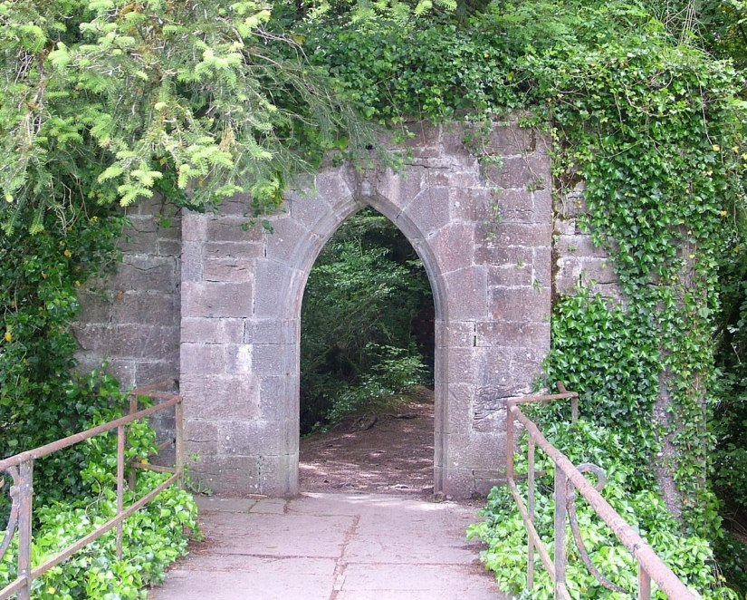 An image of the stone archway at the stone bridge over the Cong Canal at the Royal Abbey of Cong in Cong, County Mayo, Ireland. Photography by Frame To Frame - Bob and Jean