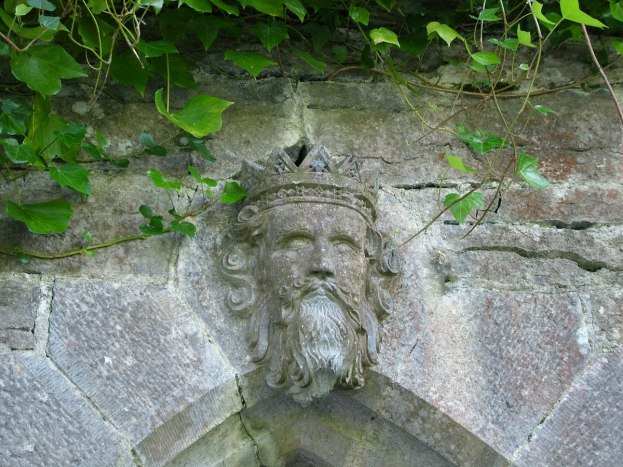 An image of the stone rendering of Rory O'Connor who was King of Connachton on the Cong Canal bridge to the Royal Abbey of Cong in Cong, County Mayo, Ireland. Photography by Frame To Frame - Bob and Jean