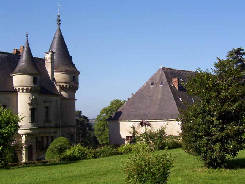 An image of the Castle turrets and rooftops at Chateau de la Bourdaisiere in the Loire Valley, France.