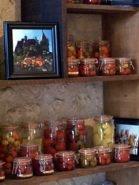 An image of various jars of tomatoes on exhibit at Chateau de la Bourdaisiere in the Loire Valley, France.