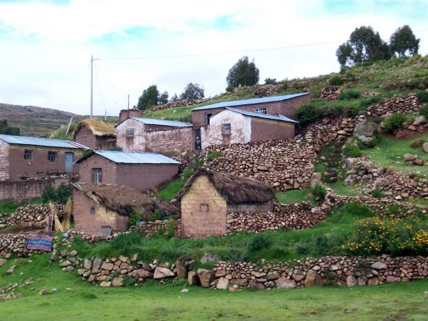 Stone houses along the Peru Rail train track in Puno, Peru, South America