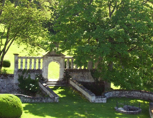 An image of the stone garden gate at Chateau de la Bourdaisiere in the Loire Valley, France.