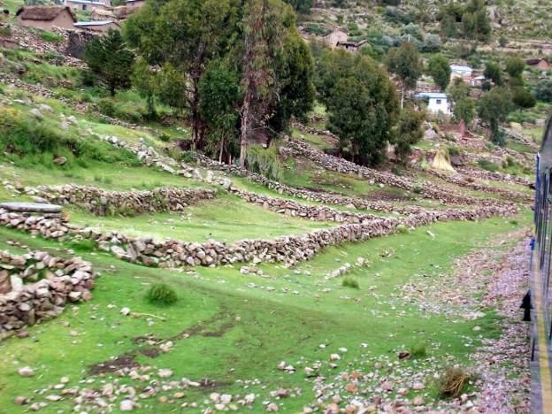 Stone fences along the Peru Rail train track in Puno, Peru, South America