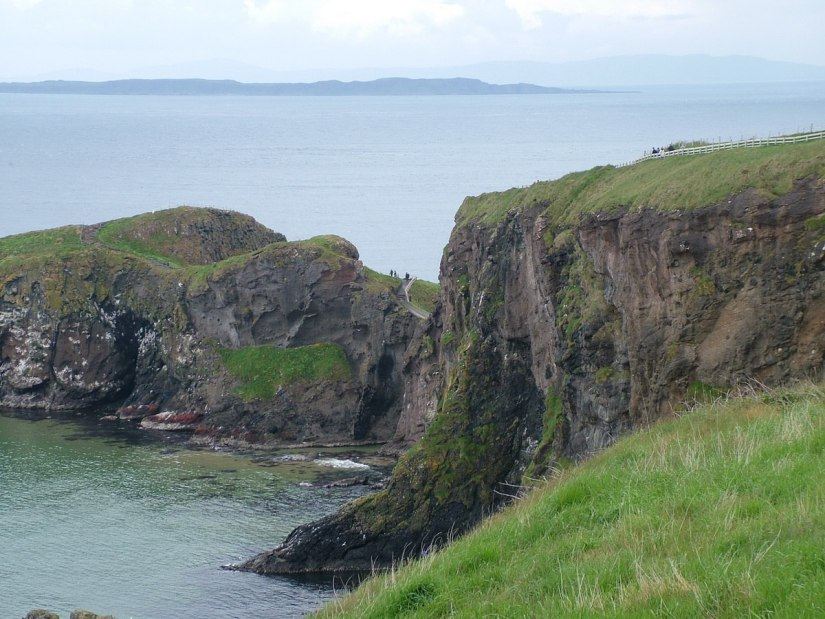 An image of cliffs and hiking trails at Carrick-a-Rede near Ballintoy in County Antrim, Northern Ireland. Photography by Frame To Frame - Bob and Jean.