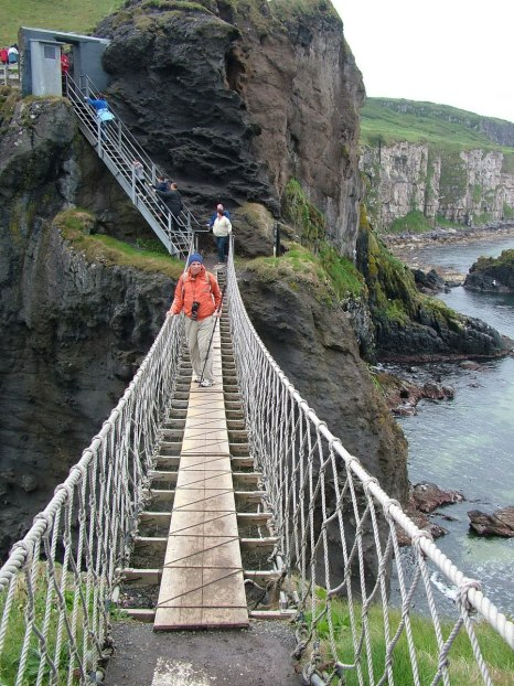 An image of Bob standing on the Carrick-a-Rede rope bridge in Northern Ireland. Photography by Frame To Frame - Bob and Jean.