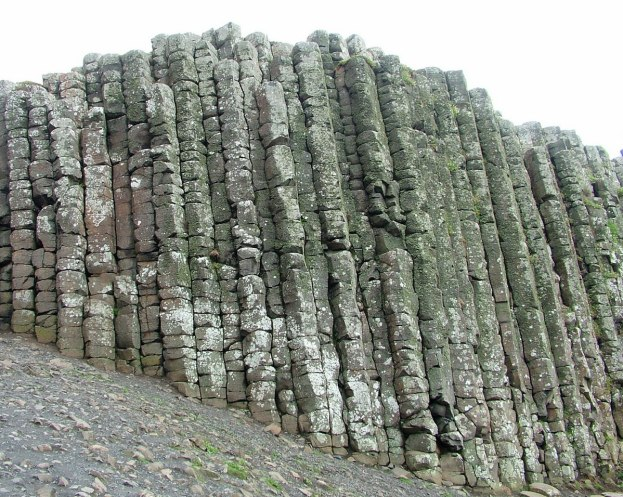 An image of a tall wall of the hexagonal basalt columns at the Giant's Causeway, near Portrush, Northern Ireland. Photography by Frame To Frame - Bob and Jean.