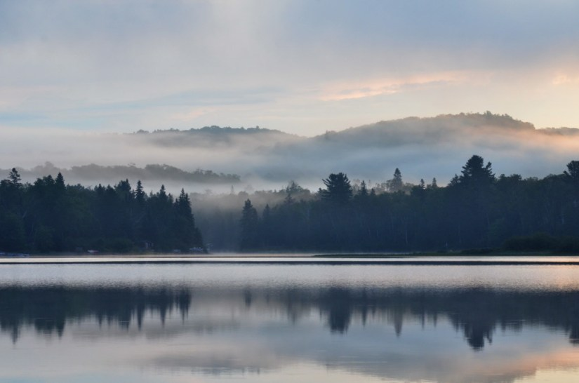 Misty summer morning at Oxtongue Lake, in Ontario, Canada