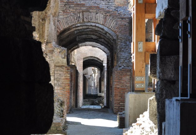 An image of the brick walls and archways in the underground of the Roman Colosseum, Rome, Italy.   Photography by Frame To Frame - Bob and Jean.