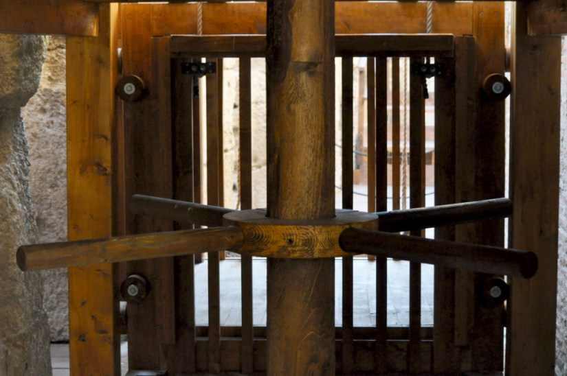 Restored elevator pulley system in the basement of the Roman Colosseum, Rome, Italy
