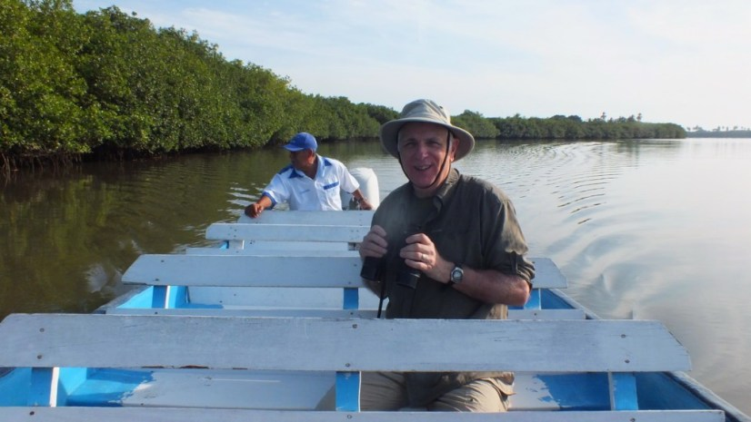 Photo of a boat on the San Cristobal River heading to the mangrove swamp near San Blas, Mexico
