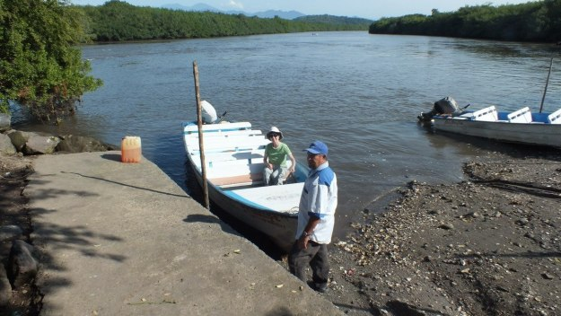 Boarding a boat in San Blas for ride through the mangrove swamp, Mexico
