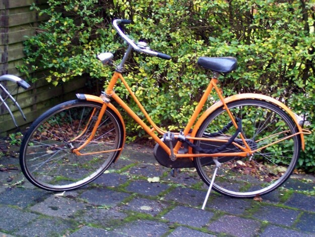orange colored bike in amsterdam, the netherlands