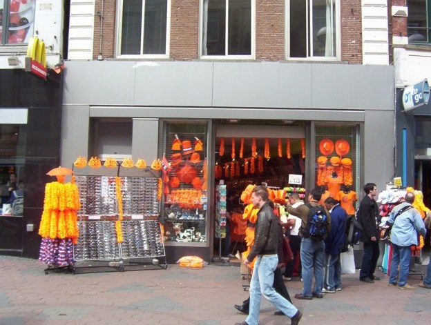orange hats and clothes for sale on queens day, the netherlands