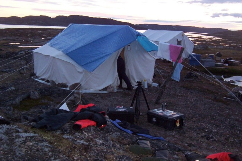 tent and camera gear on kekerten island, nunavut, canada