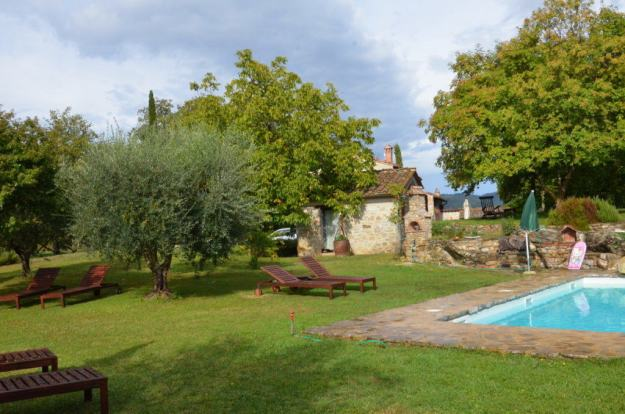 courtyard at the stone farmhouse at Il Colombaio di Cencio, Gaiole, Chianti, Tuscany, Italy