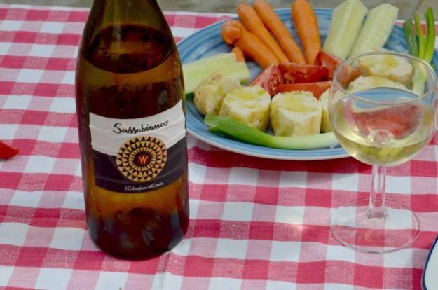 bottle of wine at lunch at il colombaio di cencio vineyard, gaiole in chianti, itay