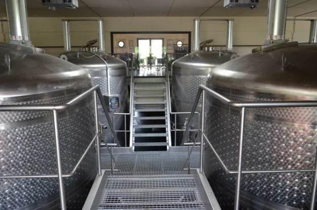 wine tanks in tank room at il colombaio di cencio vineyard, gaiole in chianti, itay