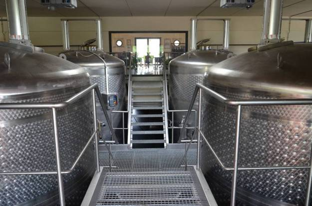 wine tanks in tank room at il colombaio di cencio vineyard, gaiole in chianti, itay