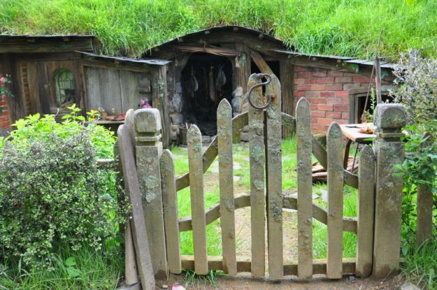 An image of a rustic wooden gate at Hobbiton in Matamata, New Zealand. Photography by Frame To Frame - Bob and Jean