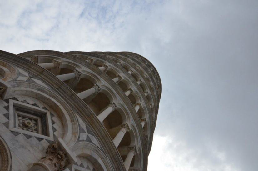 An image of a side view looking upward of the Tower of Pisa in Tuscany, Italy. Photography by Frame To Frame - Bob and Jean.