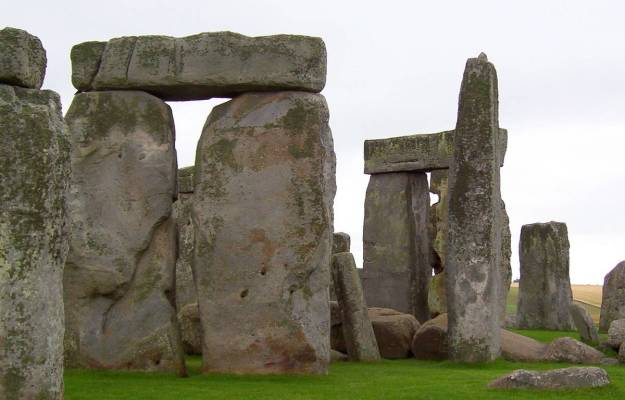 An image of the massive lintel stones sitting on the top of some of the stone pillars at Stonehenge in Wiltshire, England.  Photography by Frame To Frame - Bob and Jean