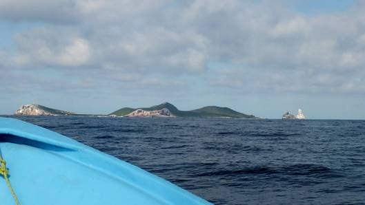 An image taken from a boat of Isla Isabel in Mexico. Photography by Frame To Frame - Bob and Jean.